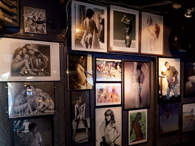 Nude pinup pictures line one wall, evoking the venue's dive bar past.